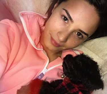 Demi Lovato no makeup selfie with Batman
